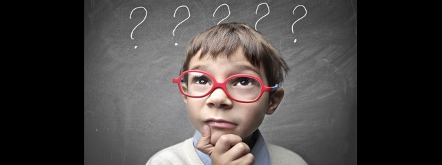 child questioning with puzzled look and question marks